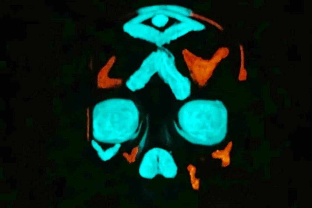 A plastic glowing after applying glow in the dark paint
